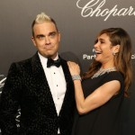 Singer Robbie Williams and his wife Ayda Field attend the Soiree Chopard 'Gold Party' on the sidelines of the 68th Cannes film festival on May 18, 2015 in Cannes, southeastern France. AFP PHOTO / JEAN CHRISTOPHE MAGNENET        (Photo credit should read JEAN CHRISTOPHE MAGNENET/AFP/Getty Images)